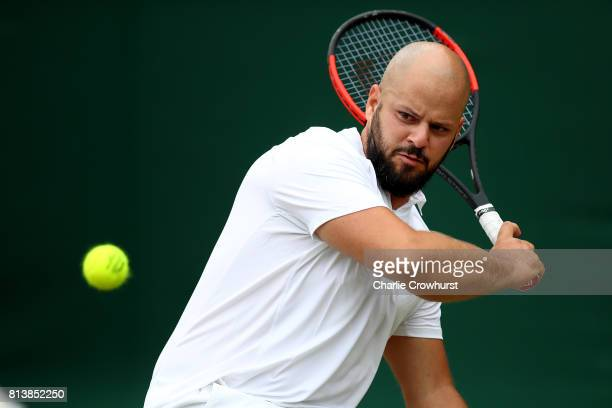 Stefan Olson of Sweden looks dejected after losing his first round wheel chair tennis mens match against Gordon Reid of Great Britain at Wimbledon on...