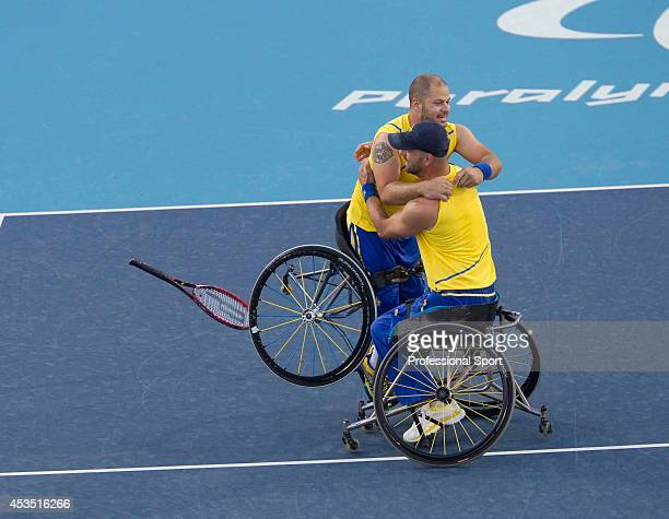 Stefan Olsson and Peter Vikstrom of Sweden celebrate victory in the Men's doubles final of the Wheelchair Tennis on day 9 of the London 2012...