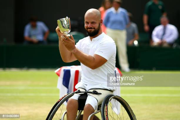 Stefan Olsson of Sweden celebrates winning his Gentlemen's Wheelchair singles final against Gustavo Fernandez of Argentina on day thirteen of the...