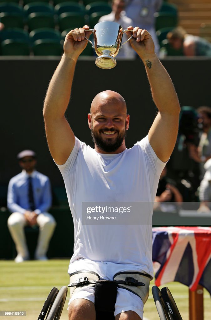 Stefan Olsson of Sweden with the trophy after winning the mens wheelchair final against Gustavo Fernandez of Argentina at the All England Lawn Tennis and Croquet Club on July 15, 2018 in London, England.