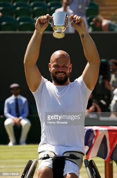 Stefan Olsson of Sweden with the trophy after winning the mens wheelchair final against Gustavo Fernandez of Argentina at the All England Lawn Tennis...