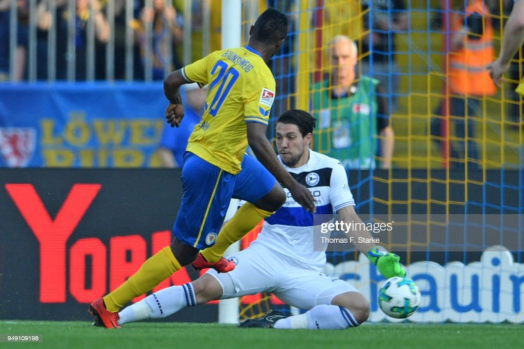 Stefan Ortega Moreno (R) of Bielefeld saves a kick by Suleiman Abdullahi of Braunschweiger during the Second Bundesliga match between Eintracht Braunschweig and DSC Arminia Bielefeld at Eintracht Stadion on April 20, 2018 in Braunschweig, Germany.