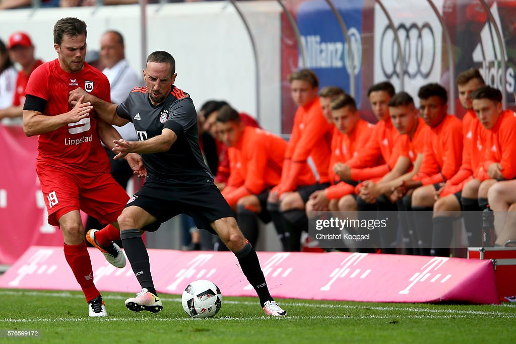 Stefan Parensen of Lippstadt challenges Franck Ribery of Bayern Muenchen during the friendly match between SV Lippstadt and FC Bayern at Stadion am Bruchbaum on July 16, 2016 in Lippstadt, Germany.