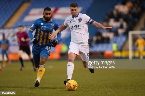 Stefan Payne of Shrewsbury Town and Anthony Gerrard of Oldham Athletic during the Sky Bet League One match between Shrewsbury Town and Oldham...