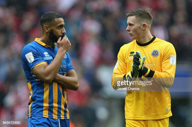 Stefan Payne of Shrewsbury Town and Dean Henderson of Shrewsbury Town speak after the Checkatrade Trophy Final match between Shrewsbury Town and...