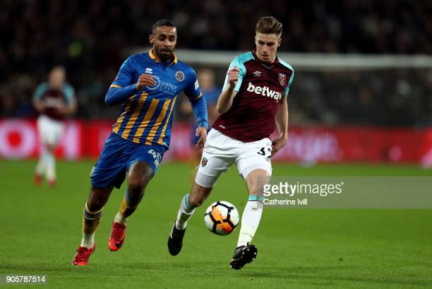 Stefan Payne of Shrewsbury Town and Reece Burke of West Ham United during the Emirates FA Cup Third Round Replay match between West Ham United and...