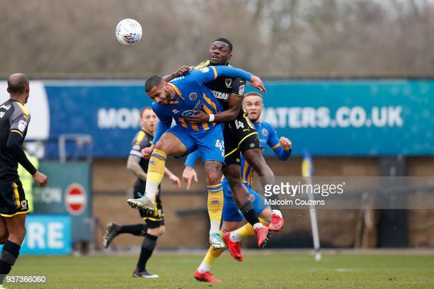 Stefan Payne of Shrewsbury Town competes with Deji Oshilaja of AFC Wimbledon during the Sky Bet League One match between Shrewsbury Town and AFC...