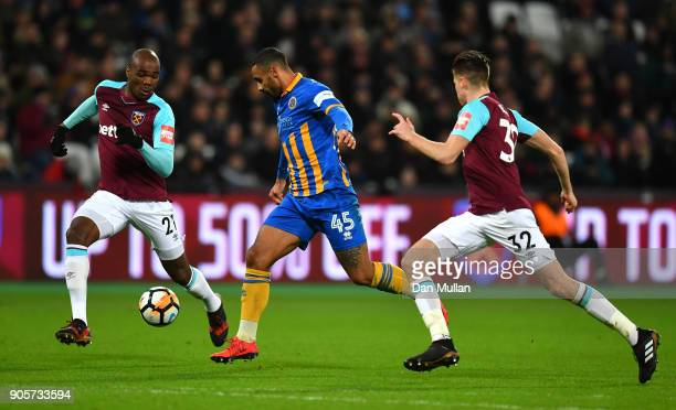 Stefan Payne of Shrewsbury Town takes on Angelo Ogbonna and Reece Burke of West Ham United during The Emirates FA Cup Third Round Replay match...