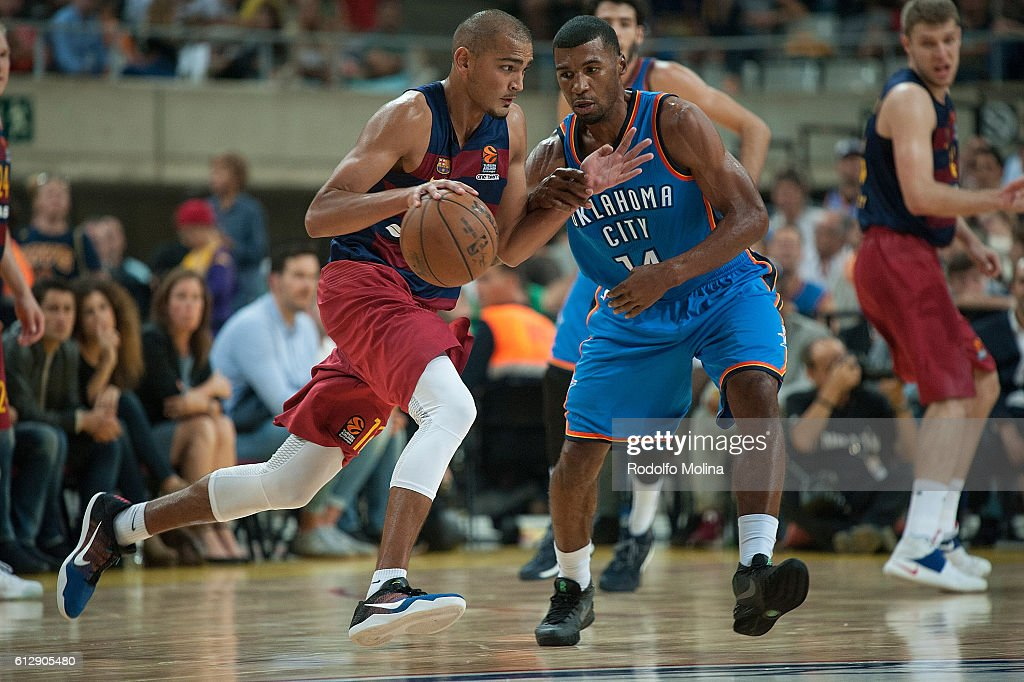 Stefan Peno, #16 of FC Barcelona Lassa competes with Ronnie Price, #14 of Oklahoma City Thunder during the NBA Global Games Spain 2016 FC Barcelona Lassa v Oklahoma City Thunder at Palau Sant Jordi on October 5, 2016 in Barcelona, Spain.