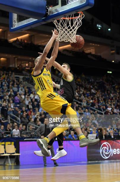 Stefan Peno of Alba Berlin and Bastian Doreth of medi Bayreuth during the easyCredit BBL game between Alba Berlin and medi Bayreuth at MercedesBenz...