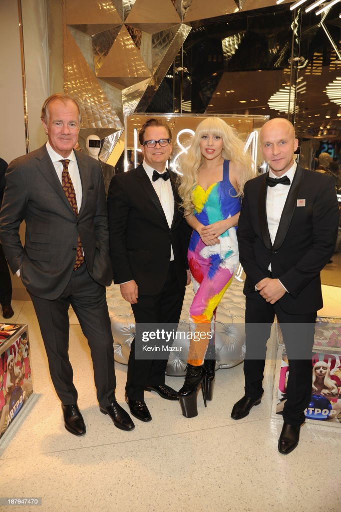 Stefan Persson, Fredrick Svortling, Lady Gaga and Daniel Kulle pose inside the new epic H&M store in Times Square on November 13, 2013 in New York City.