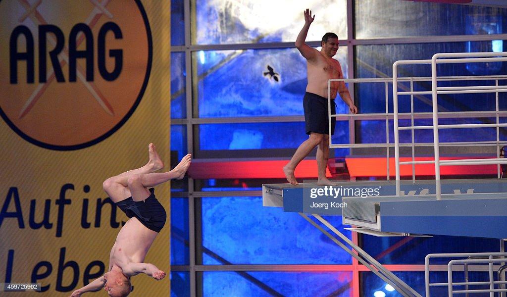 Stefan Raab (L) and Elton attend the TV show 'TV Total Turmspringen' ('TV Total high diving') on November 29, 2014 in Munich, Germany.