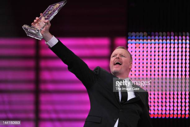 Stefan Raab gestures as he receives the Innovation Rose Award during the Rose d'Or television festival award ceremony held at the KKL on May 10, 2012...
