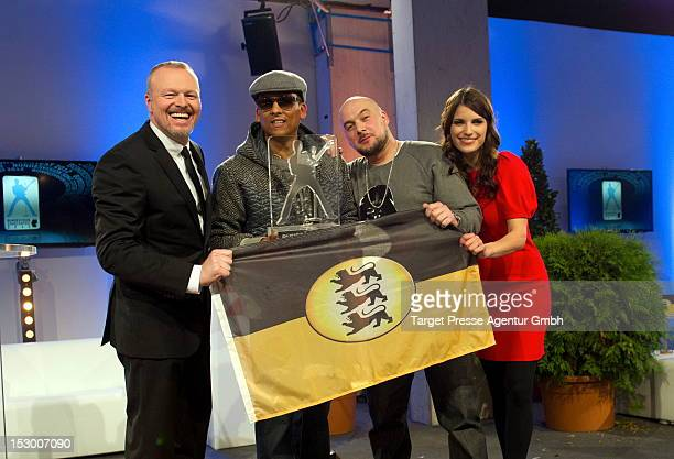 Stefan Raab, Xavier Naidoo, Kool Savas and Sandra Riess pose for the media after the 'Bundesvision Song Contest 2012' at the Max-Schmeling-Halle on...