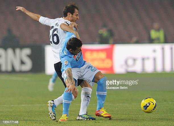 Stefan Radu of Lazio and Ezequiel Lavezzi of Napoli in action during the Serie A match between SSC Napoli and SS Lazio at Stadio San Paolo on...