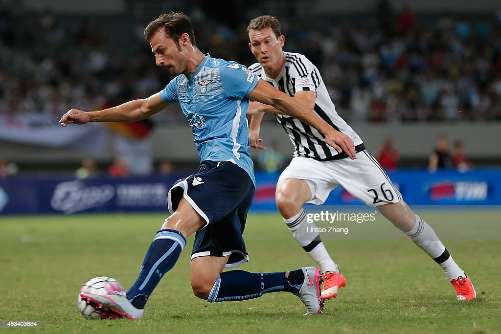 Stefan Radu (L) of Lazio contests the ball against Stephan Lichtsteiner of Juventus FC during the Italian Super Cup final football match between Juventus and Lazio at Shanghai Stadium on August 8, 2015 in Shanghai, China.