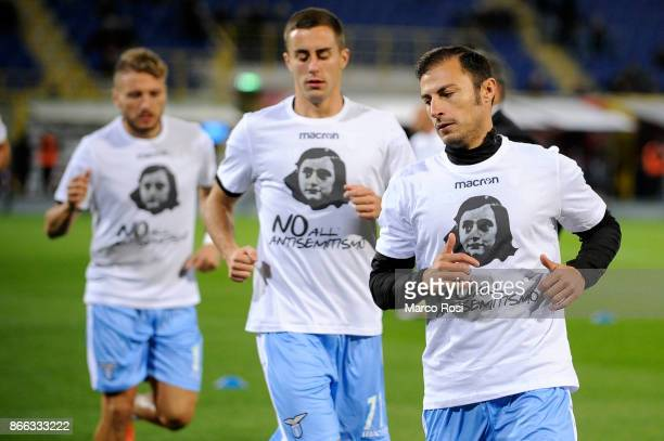 Stefan Radu of Lazio wears a shirt depicting Anne Frank saying no to antiSemitism in response to antisemitic graffiti left by their fans at a...