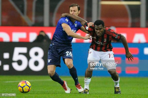 Stefan Radu of SS Lazio compete for the ball with Franck Kessie of AC Milan during the TIM Cup match between AC Milan and SS Lazio at Stadio Giuseppe...