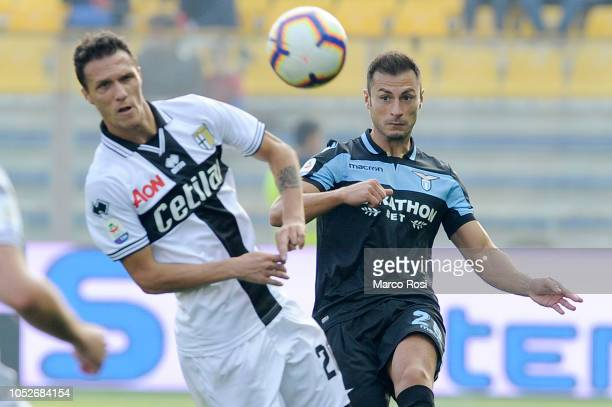 Stefan Radu of SS Lazio compete for the ball with Luca Siligardi of Parma Calcio during the Serie A match between Parma Calcio and SS Lazio at Stadio...