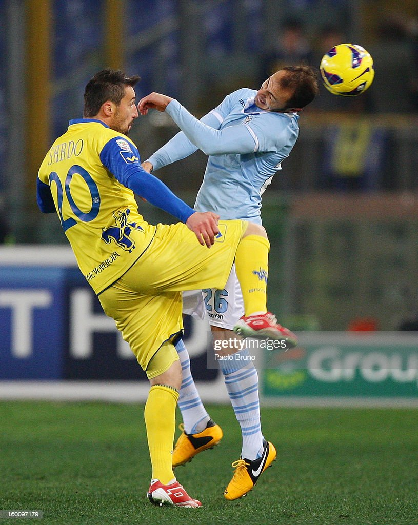 Stefan Radu (R) of S.S. Lazio competes for the ball with Gennaro Sardo of AC Chievo during the Serie A match between S.S. Lazio and AC Chievo Verona at Stadio Olimpico on January 26, 2013 in Rome, Italy.