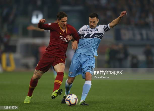 Stefan Radu of SS Lazio competes for the ball with Nicolo' Zaniolo of AS Roma during the Serie A match between SS Lazio and AS Roma at Stadio...