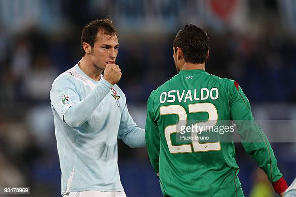 Stefan Radu of SS Lazio gestures to Pablo Daniel Osvaldo of Bologna FC during the Serie A match between Lazio and Bologna at Stadio Olimpico on...