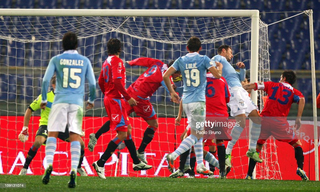 Stefan Radu (R-2nd) of S.S. Lazio scores the opening goal during the TIM Cup match between S.S. Lazio and Calcio Catania at Stadio Olimpico on January 8, 2013 in Rome, Italy.