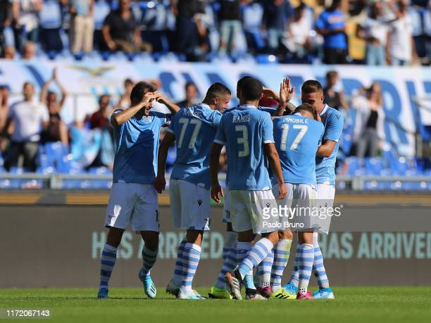 Stefan Radu with his teammates of SS Lazio celebrates after scoring the team's second goal during the Serie A match between SS Lazio and Genoa CFC at...
