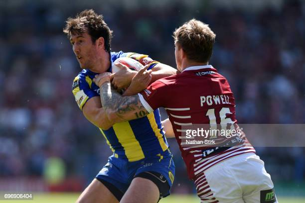 Stefan Ratchford of Warrington Wolves and Sam Powell of Wigan Warriors in action during the Ladbrokes Challenge Cup QuarterFinal match between...