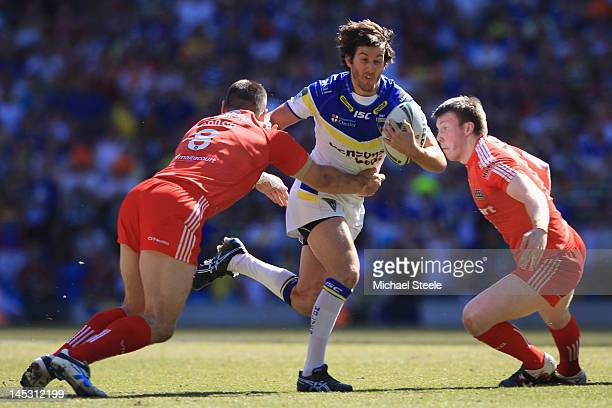 Stefan Ratchford of Warrington Wolves cuts between Ben Cross and Paddy Flynn of Widnes Vikings during the Stobart Super League 'Magic Weekend' match...