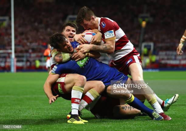 Stefan Ratchford of Warrington Wolves is tackled during the BetFred Super League Grand Final between Warrington Wolves v Wigan Warriors at Old...