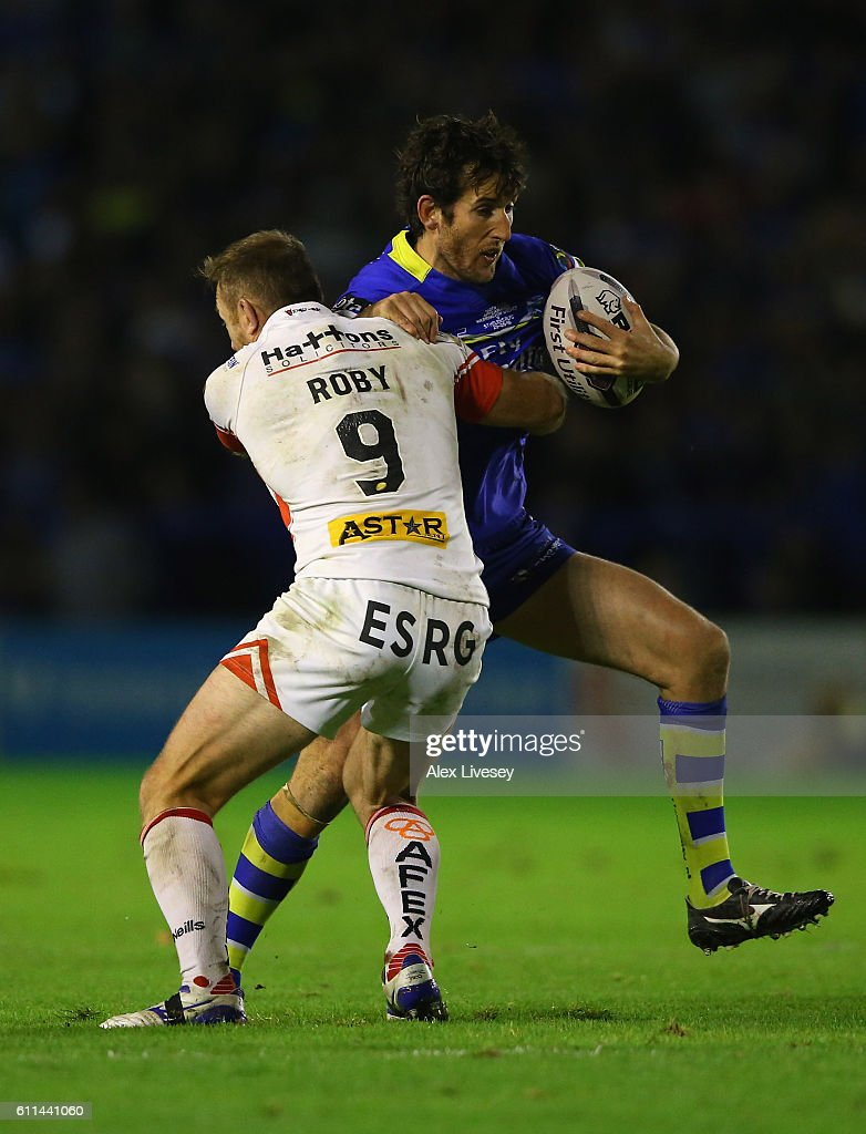 Stefan Ratchford of Warrington Wolves is tackled James Roby of St Helens during the First Utility Super League Semi Final match between Warrington Wolves and St Helens at The Halliwell Jones Stadium on September 29, 2016 in Warrington, England.