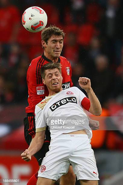 Stefan Reinartz of Leverkusen and Andreas Lambertz of Duesseldorf go up for a header during the Bundesliga match between Bayer 04 Leverkusen and...
