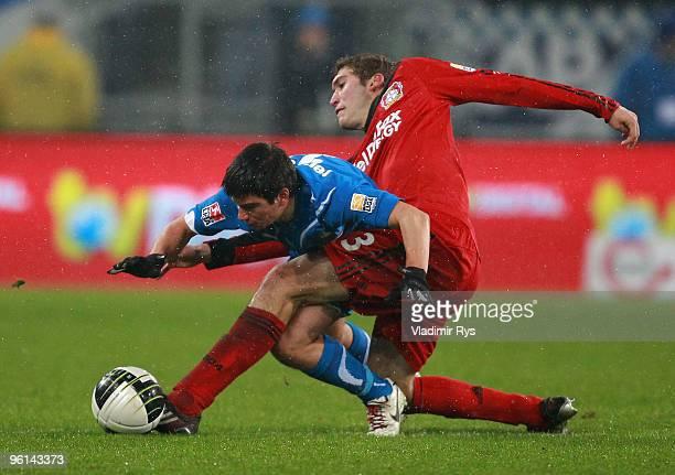 Stefan Reinartz of Leverkusen and Marco Terrazzino of Hoffenheim battle for the ball during the Bundesliga match between 1899 Hoffenheim and Bayer...