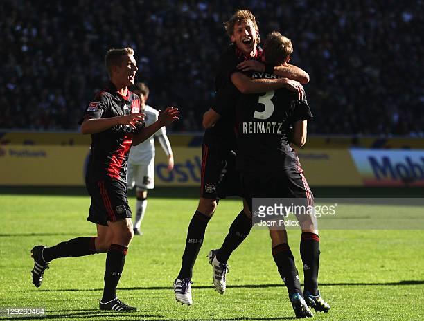 Stefan Reinarzt of Leverkusen celebrates with his team mates after scoring his team's first goal during the Bundesliga match between Borussia...