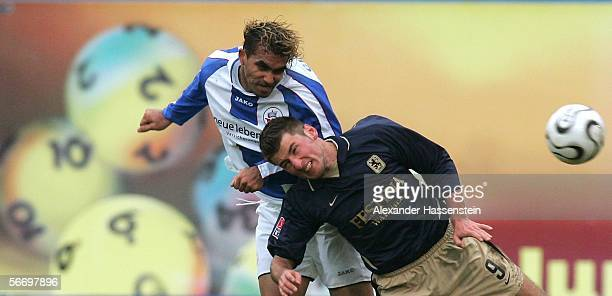 Stefan Reisinger of Munich, challenges for the ball with Gledson Da Silva Menezes of Rostock during the Second Bundesliga match between Hansa Rostock...