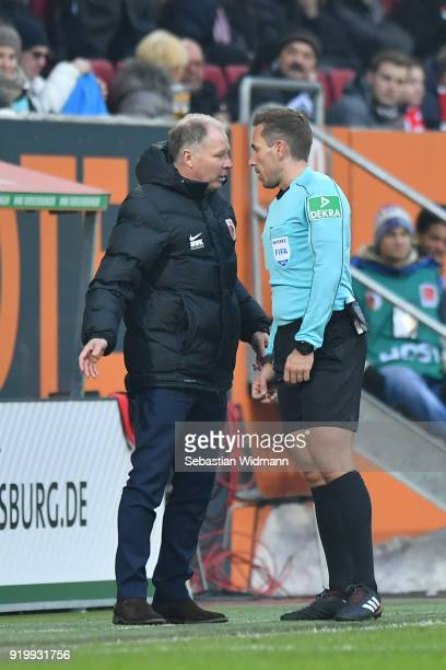 Stefan Reuter argues with referee Tobias Stieler during the Bundesliga match between FC Augsburg and VfB Stuttgart at WWKArena on February 18 2018 in...