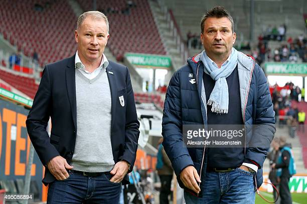 Stefan Reuter manager of Augsburg talks to Christian Heidel manager of Mainz prior to the Bundesliga match between FC Augsburg and 1 FSV Mainz 05 at...