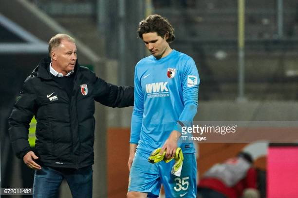 Stefan Reuter of Augsburg and Goalkeeper Marvin Hitz of Augsburg looks on during the Bundesliga match between FC Augsburg and FC Ingolstadt 04 at WWK...