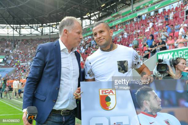Stefan Reuter of Augsburg and Raul Bobadilla looks on during a Bundesliga match between FC Augsburg and Borussia Moenchengladbach at WWK Arena on...