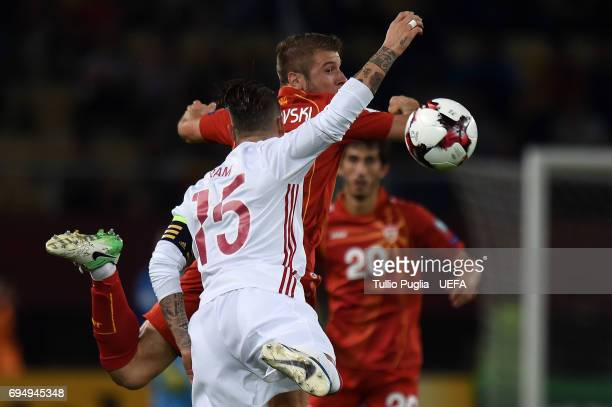 Stefan Ristovski of FYR Macedonia and David Silva of Spain compete for the ball during the FIFA 2018 World Cup Qualifier between FYR Macedonia and...