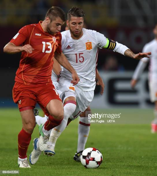 Stefan Ristovski of FYR Macedonia and Sergio Ramos of Spain compete for the ball during the FIFA 2018 World Cup Qualifier between FYR Macedonia and...