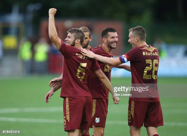 Stefan Ristovski of HNK RIjeka celebrates with team mates after scoring the fourth goal during the UEFA Champions League second qualifying round...