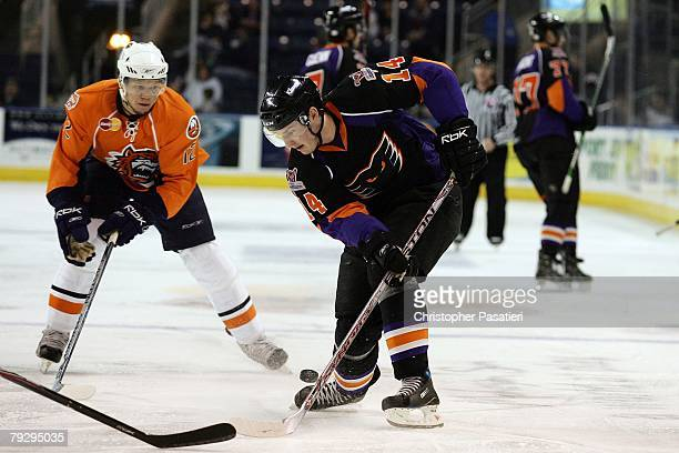 Stefan Ruzicka of the Philadelphia Phantoms plays for possession of the puck against Kyle Okposo of the Bridgeport Sound Tigers during the second...
