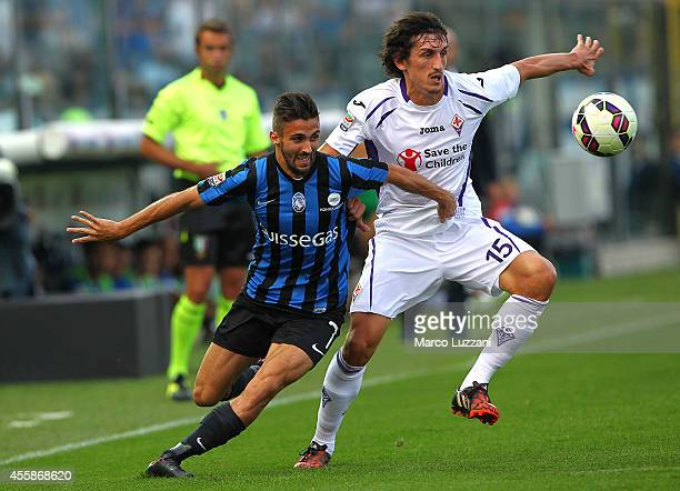 Stefan Savic of ACF Fiorentina competes for the ball with Marco D Alessandro of Atalanta BC during the Serie A match between Atalanta BC and ACF...