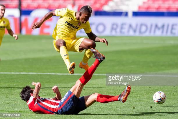Stefan Savic of Atletico de Madrid and Pervis Estupinan of Villarreal CF battle for the ball during the La Liga Santader match between Atletico de...