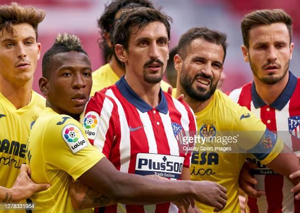 Stefan Savic of Atletico de Madrid battle for the ball with Pervis Estupinan Villarreal CF during the La Liga Santader match between Atletico de...