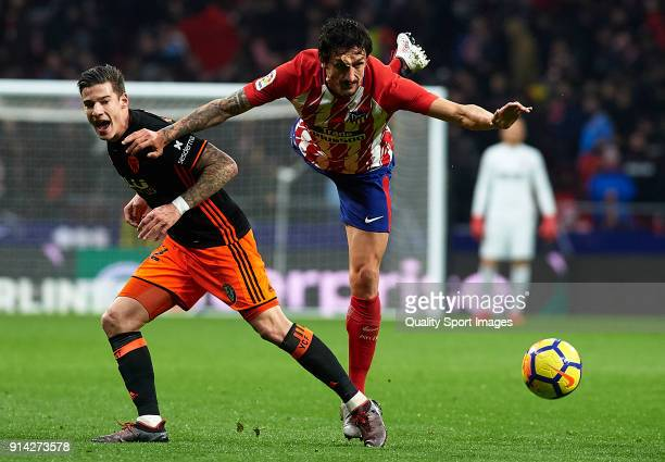 Stefan Savic of Atletico de Madrid competes for the ball with Santi Mina of Valencia during the La Liga match between Atletico Madrid and Valencia CF...