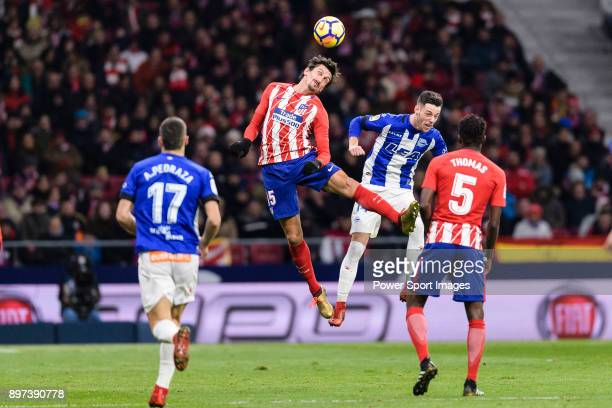 Stefan Savic of Atletico de Madrid fights for the ball with Jorge Franco Alviz of Deportivo Alaves during the La Liga 201718 match between Atletico...