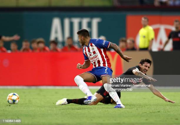 Stefan Savic of Atletico Madrid and Alexis Vega of Guadalajara battle for the ball during their 2019 International Champions Cup match at Globe Life...